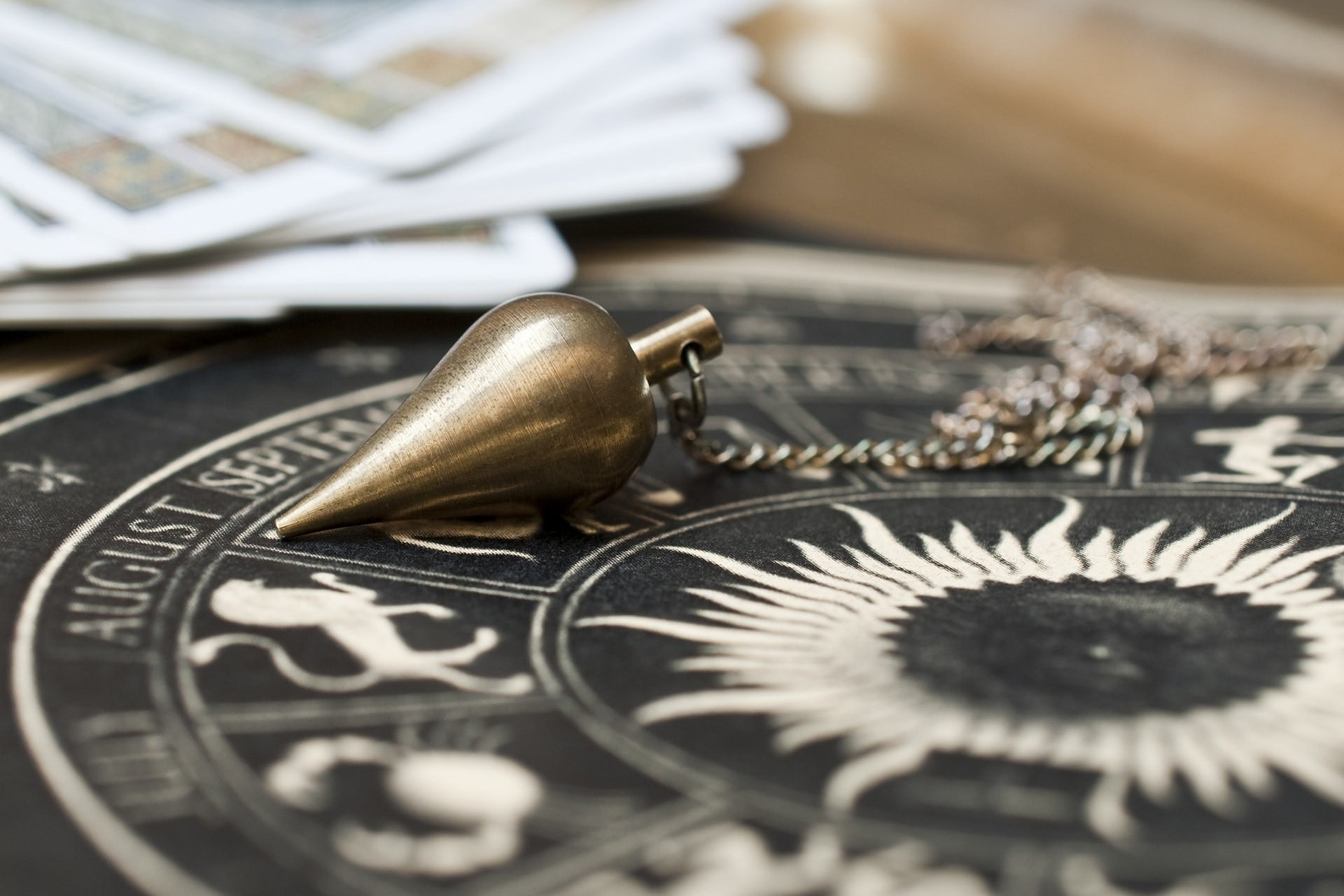 Pendulum with astrological card