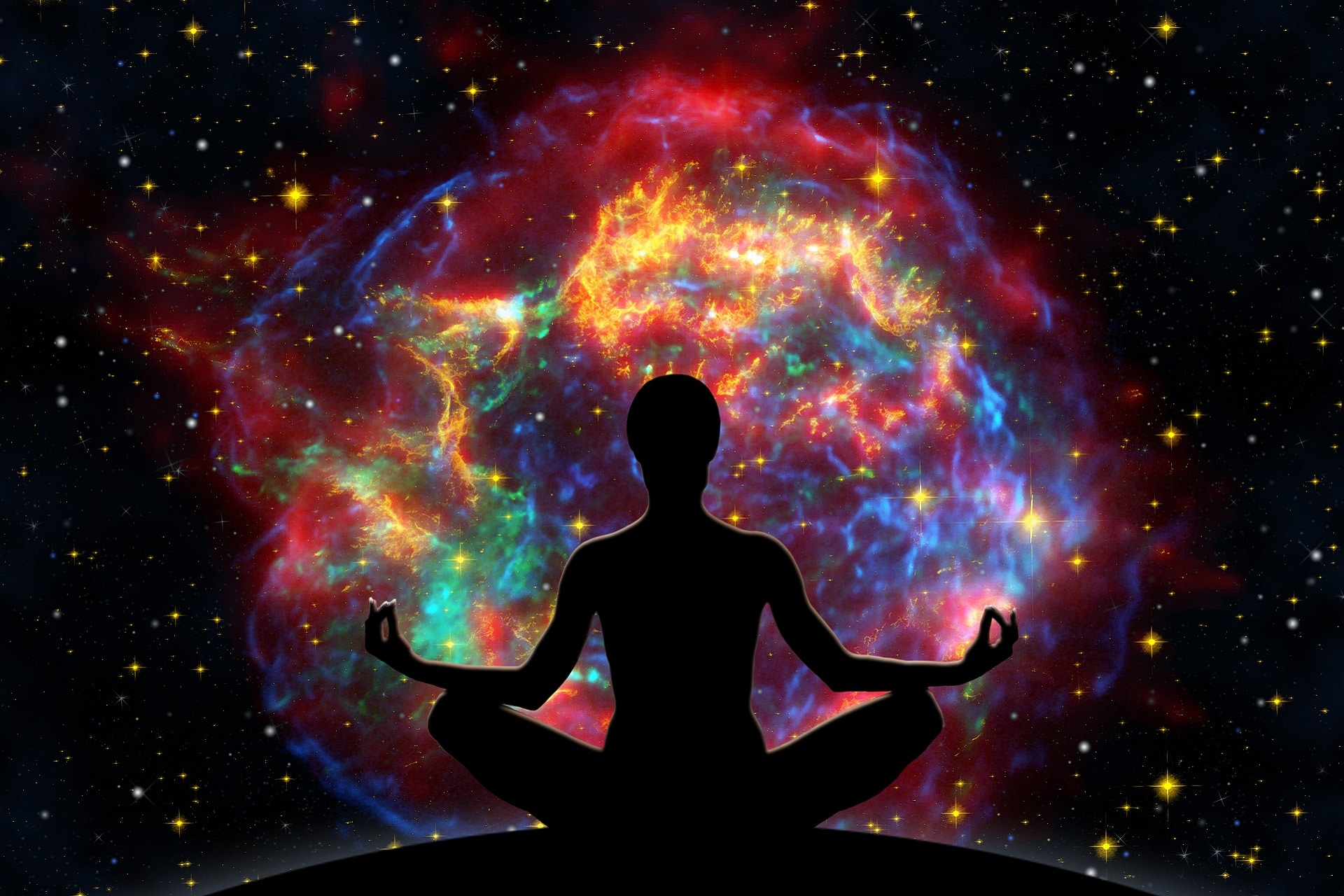 Female yoga figure against universe background with Supernova explosion.