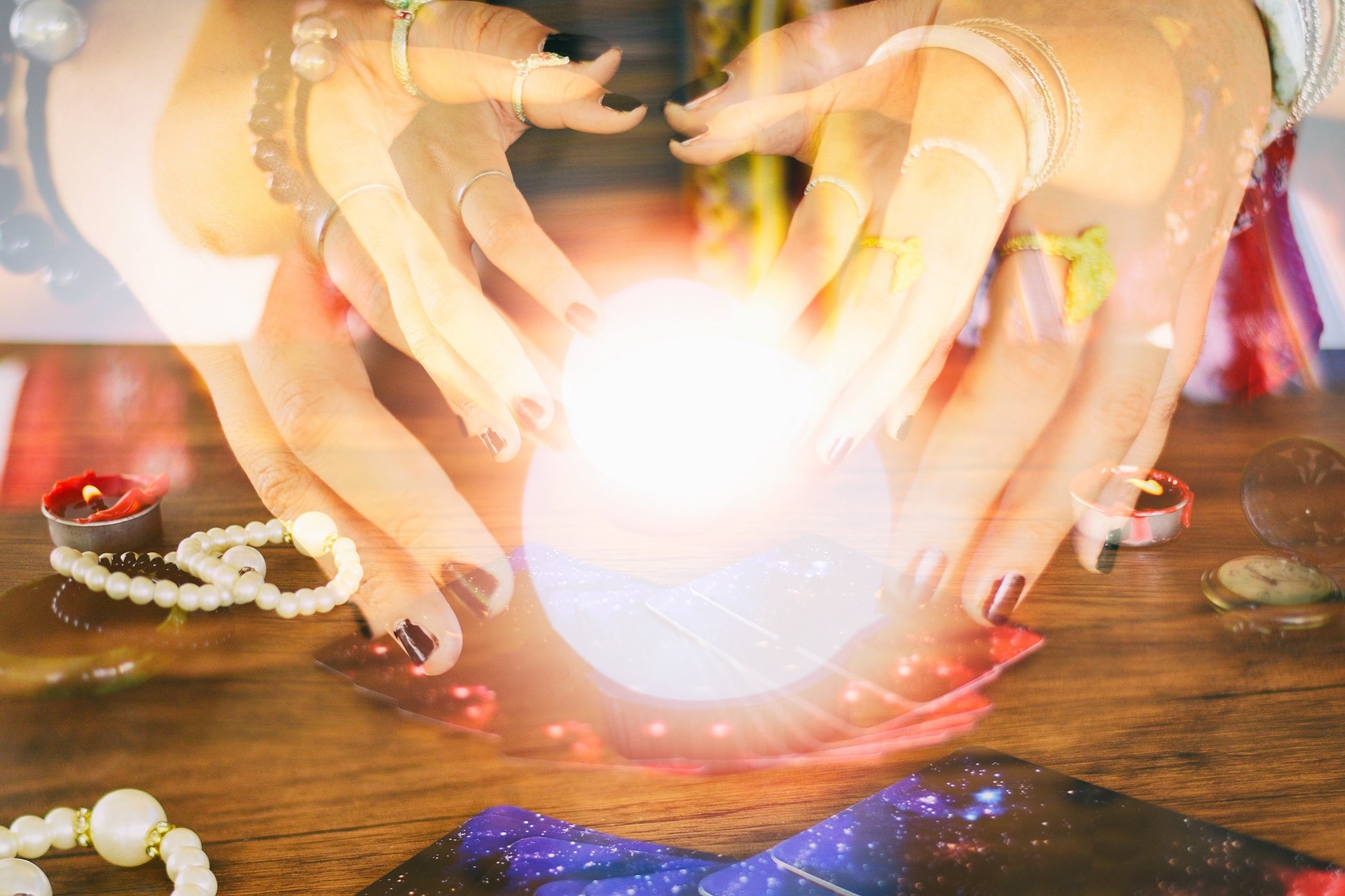 Psychic readings and clairvoyance concept - Crystal ball fortune teller hands