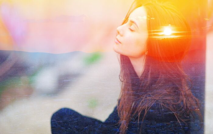 woman meditating outdoors with eyes closed