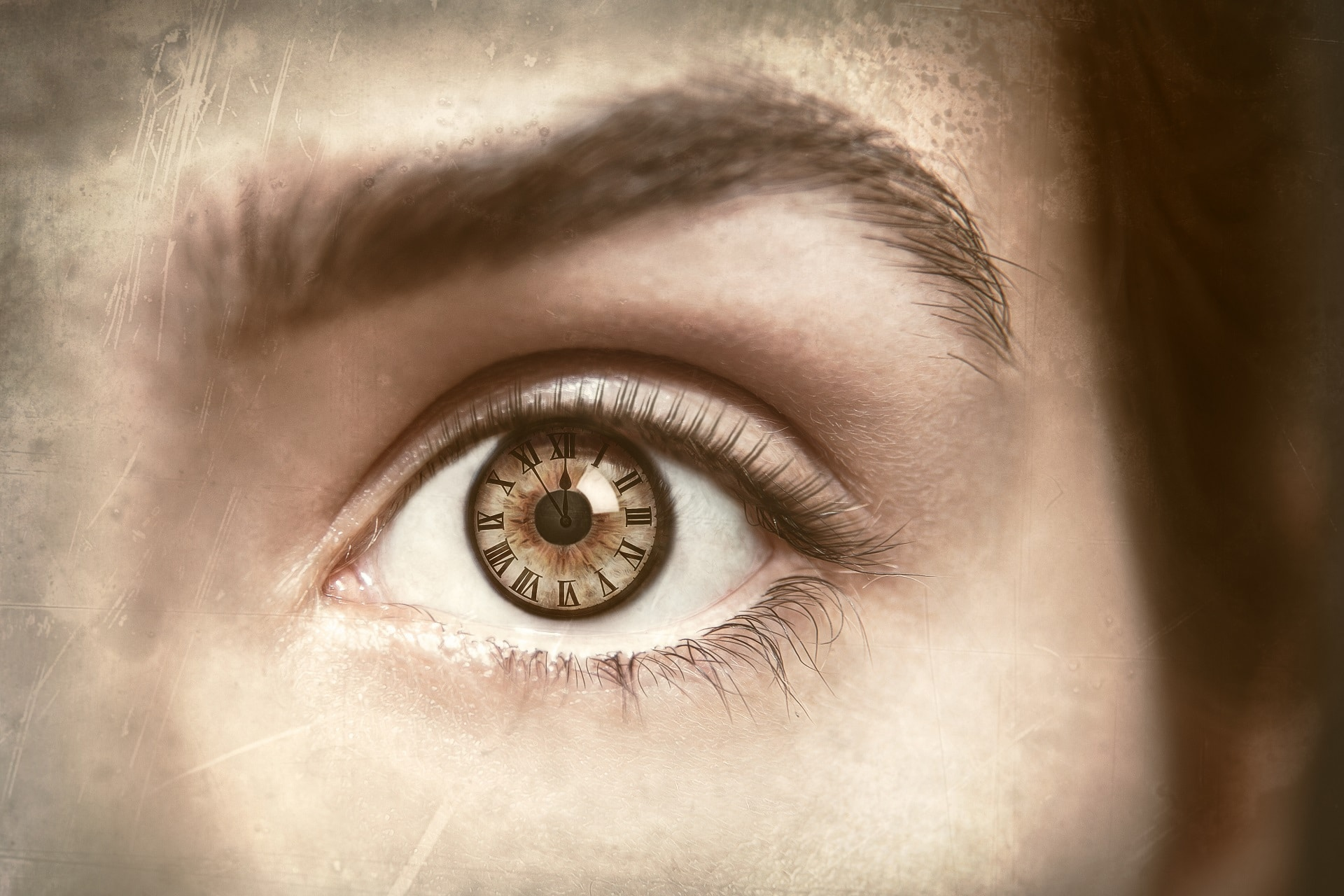 image of a clock in a woman's eye