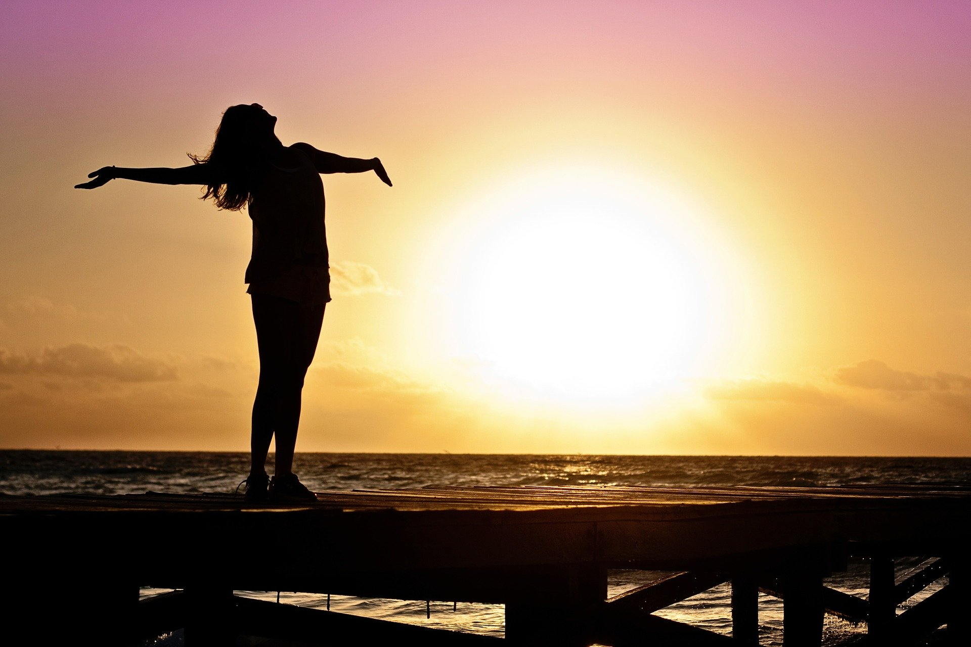 woman feeling happy at sunrise