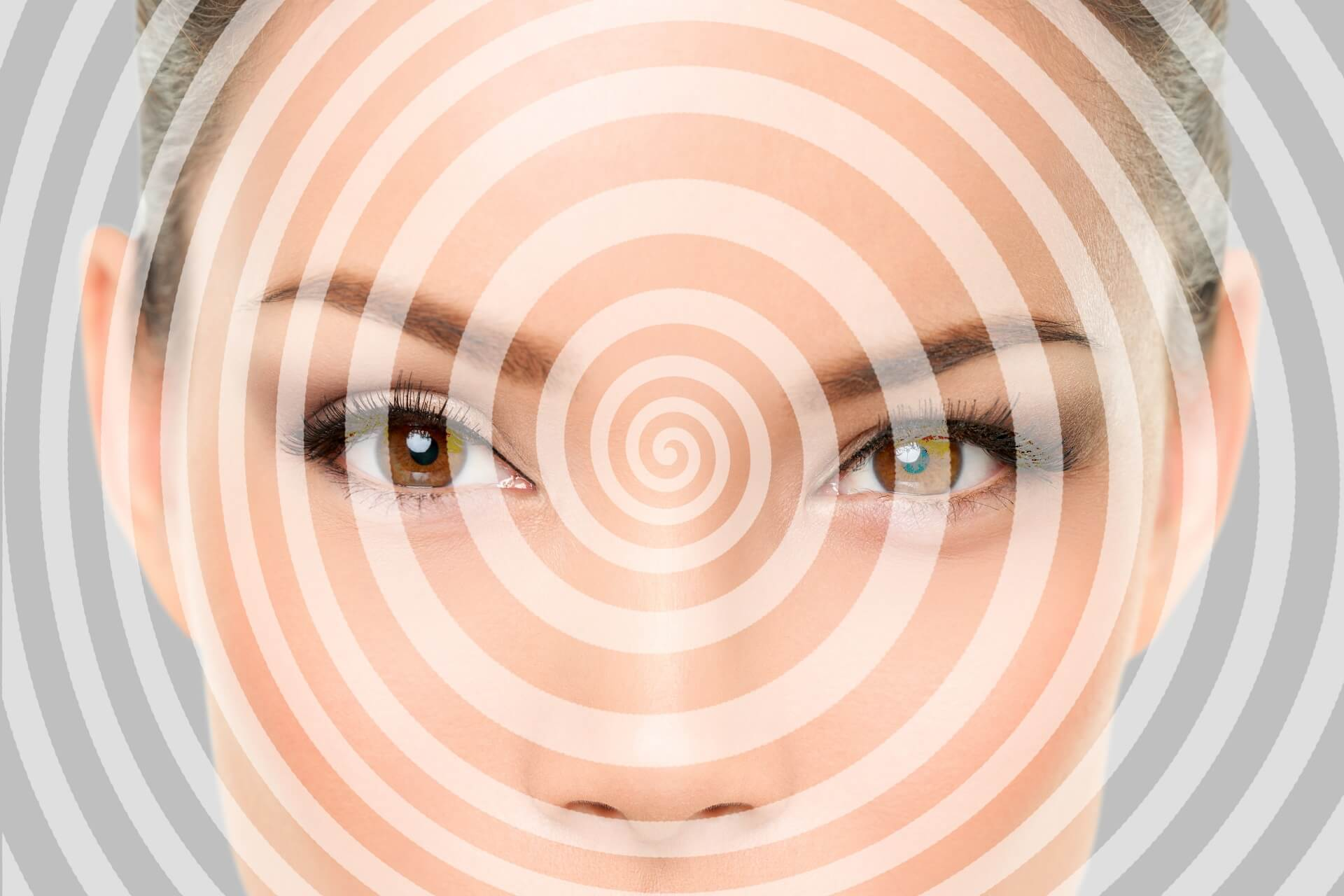 hypnosis circle in front of a woman's eyes