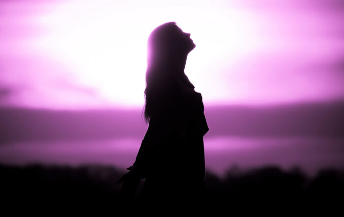 Silhouette in front of sunset or sunrise in summer nature.