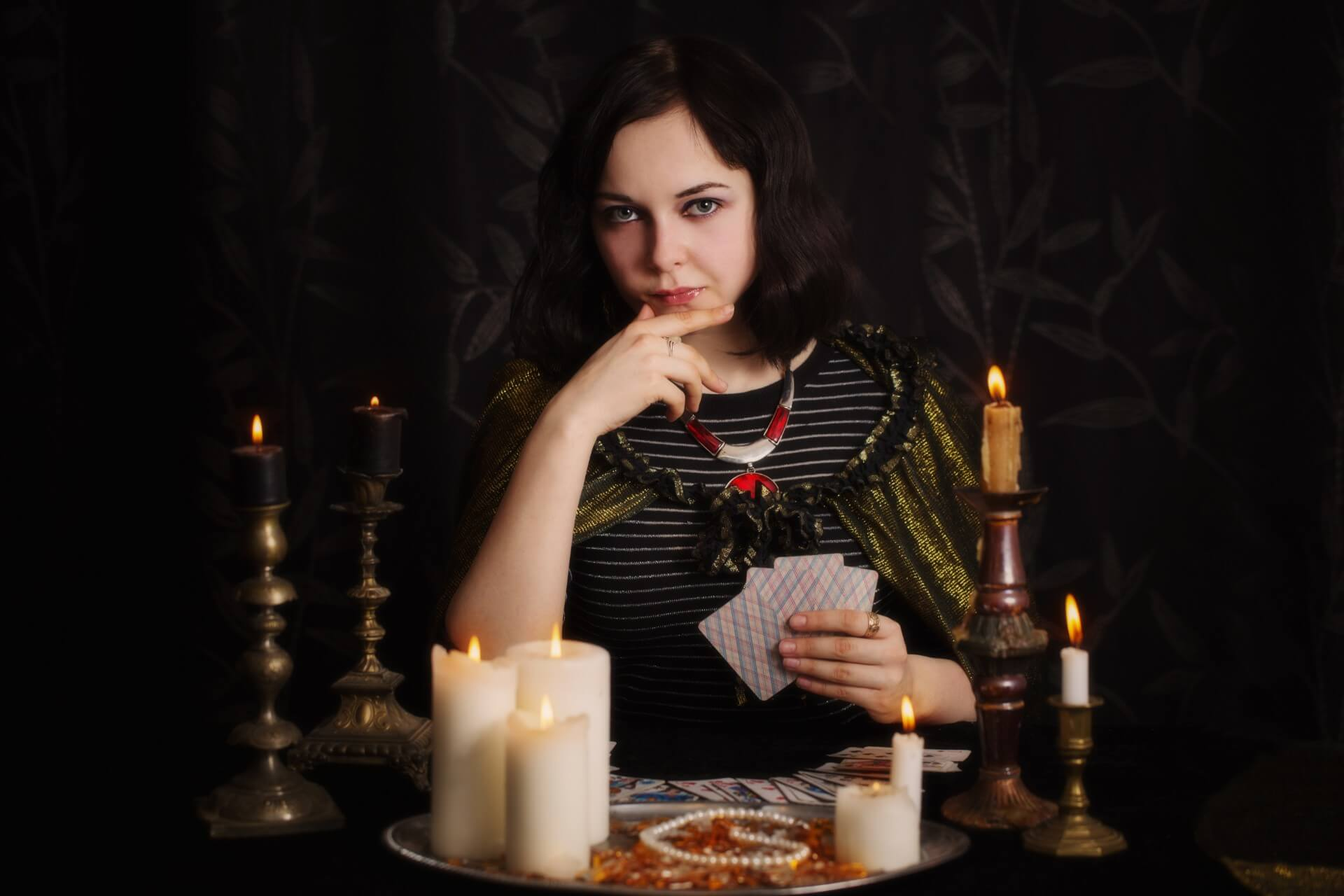 A psychic reader with divination cards