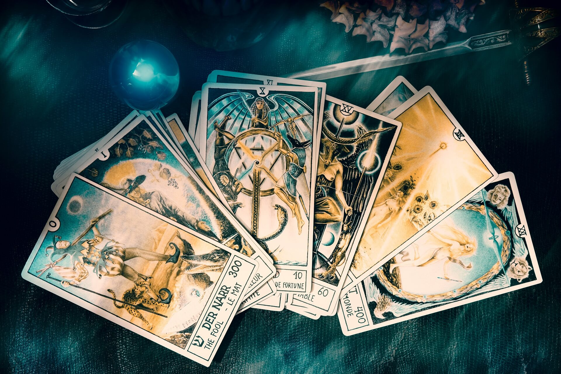View of tarot card on the table under candlelight